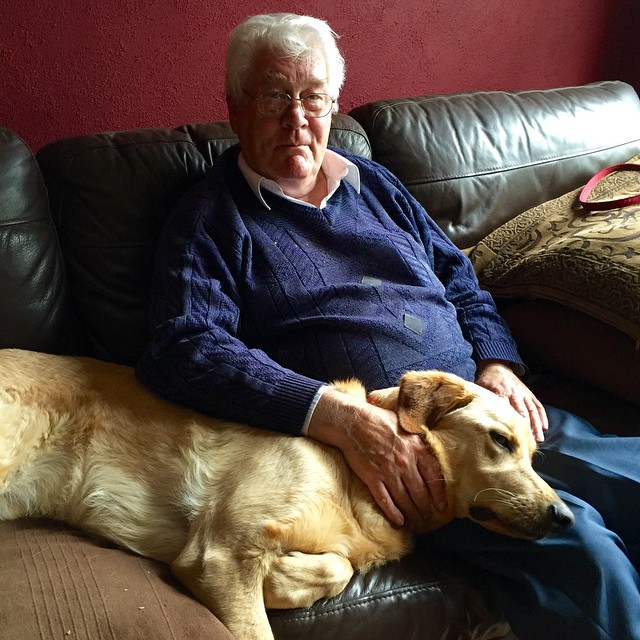 My Dad having a nice cuddle with Oscar. Mutual adoration…